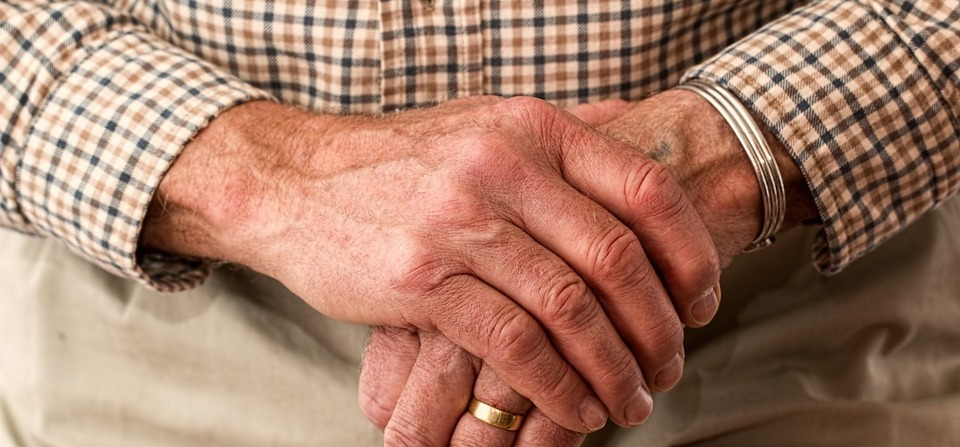 Elderly man with arthritis in his hands