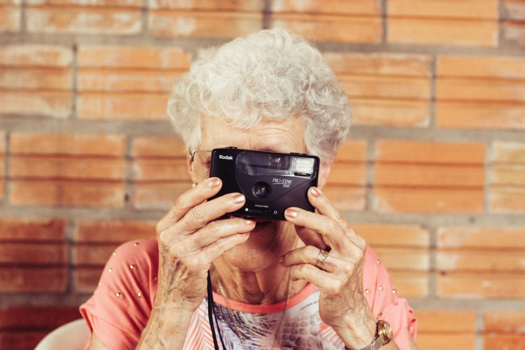 elderly women taking a picture