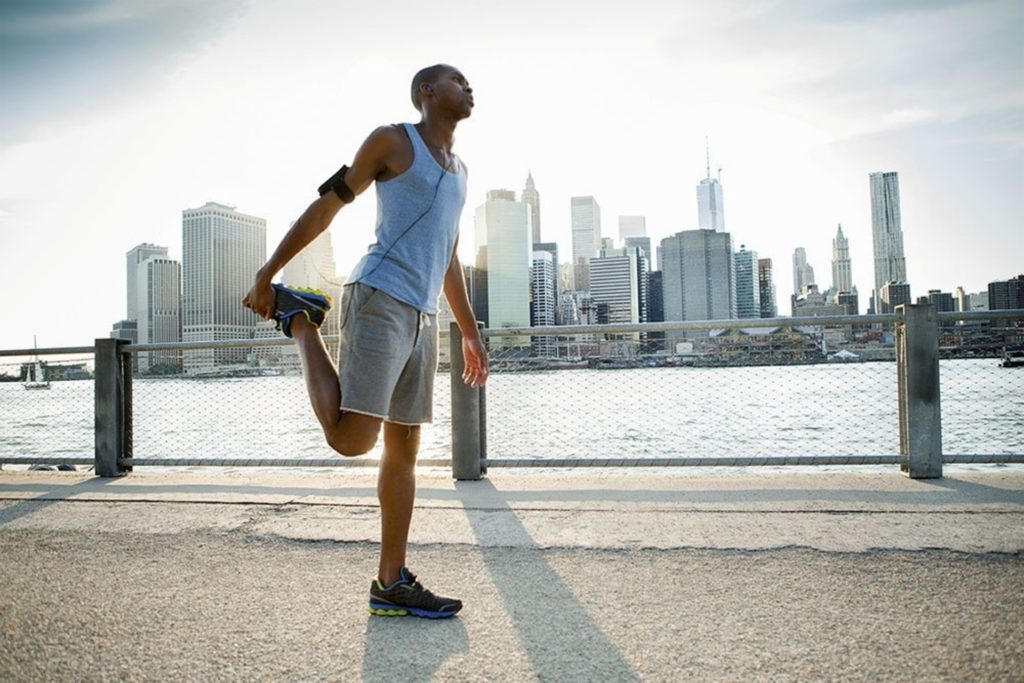 Athlete in the city stretching before a run